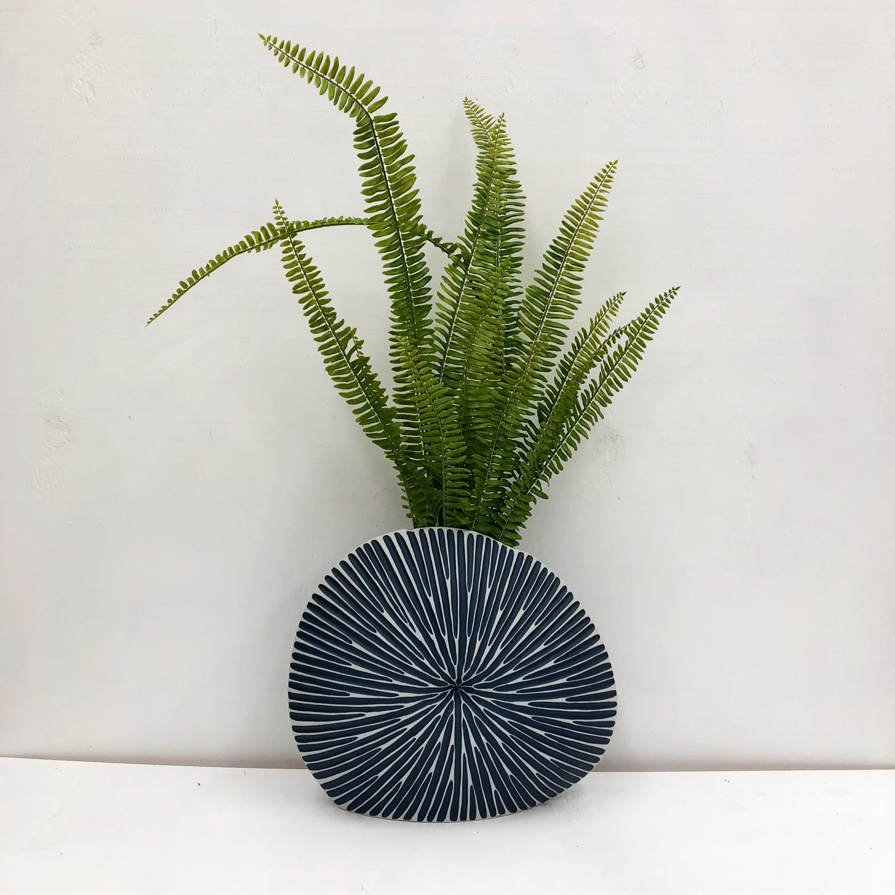 Diva Round Handmade Vase - Blue - front view with plant