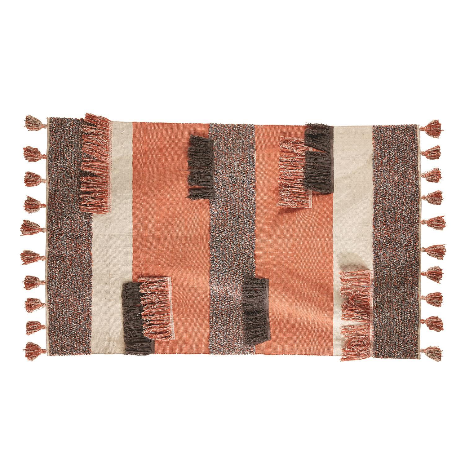 Topanga Woven Rug with Fringe and Tallels on white background