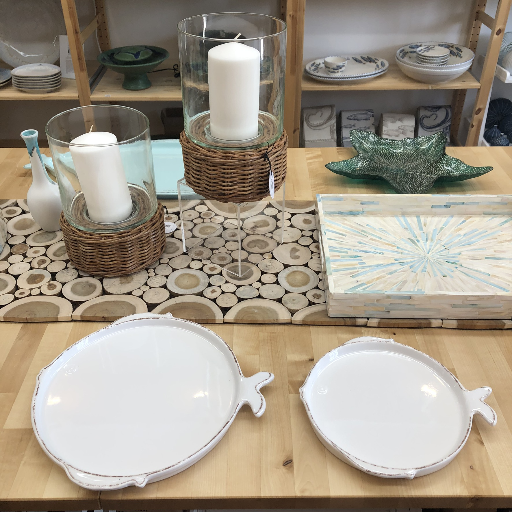 fish shaped salad plate and dinner plate on wooden table