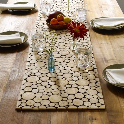 Branch table runner on table with place settings