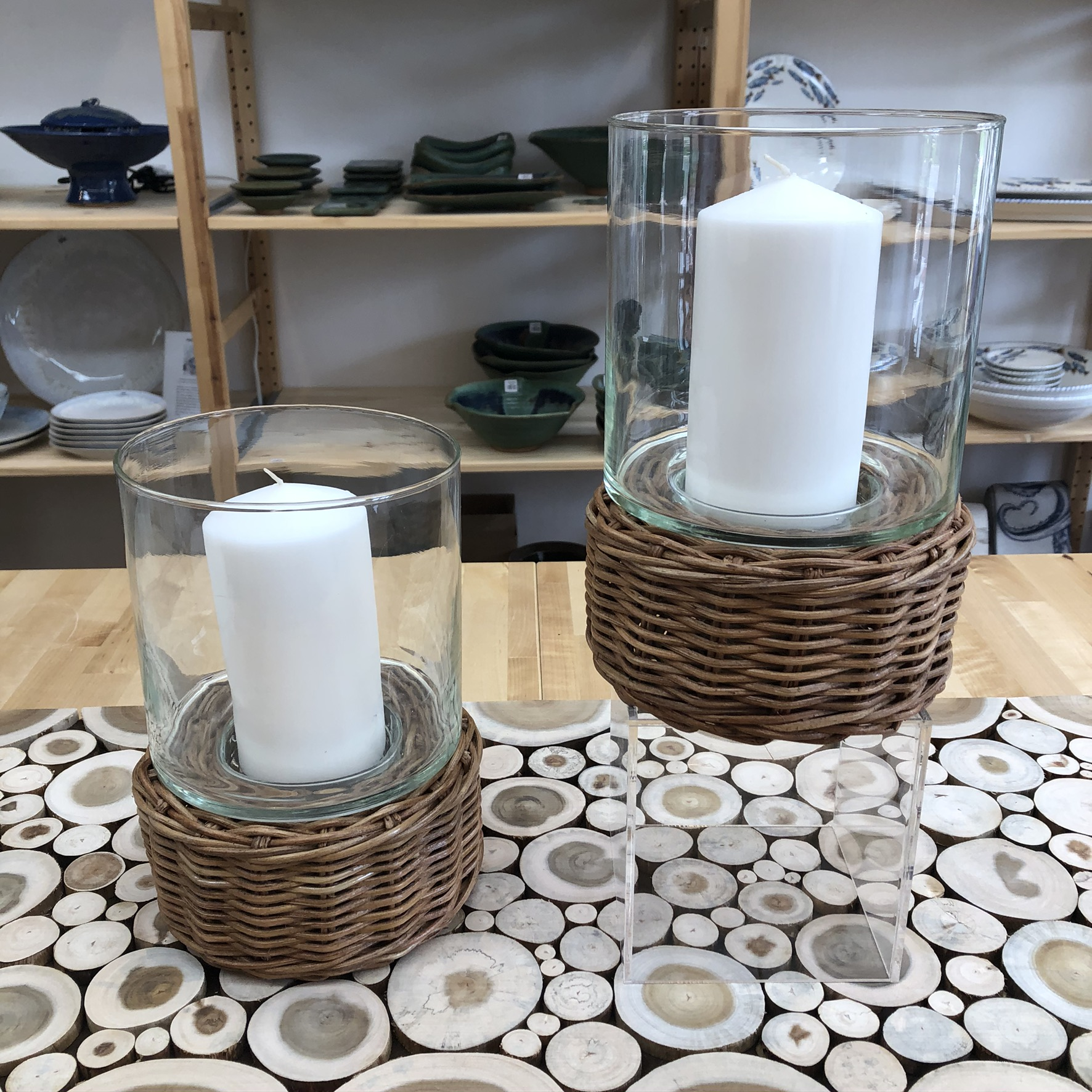 two candle holders - one on a platform, one on table