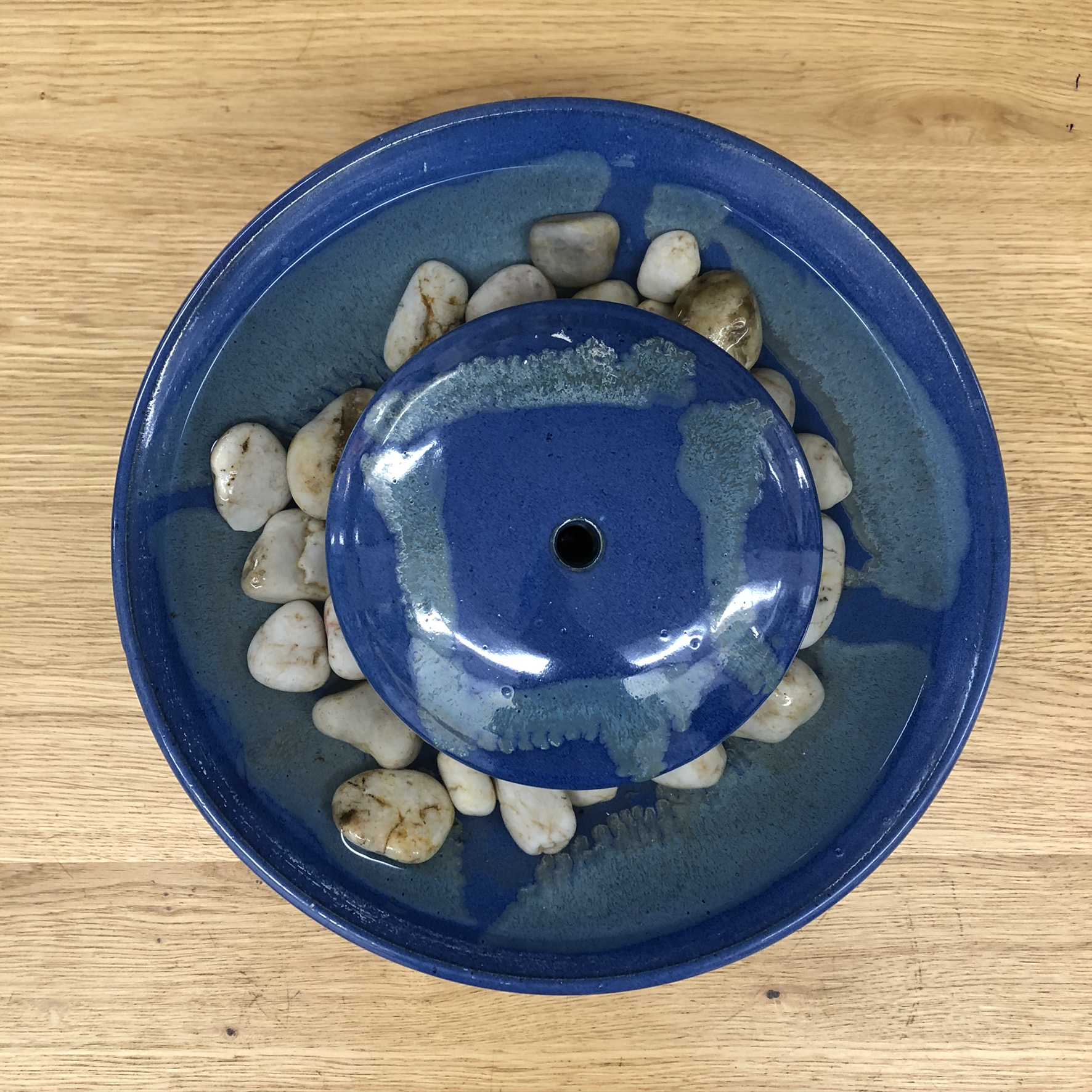 Ceramic tabletop fountain - top view - blue
